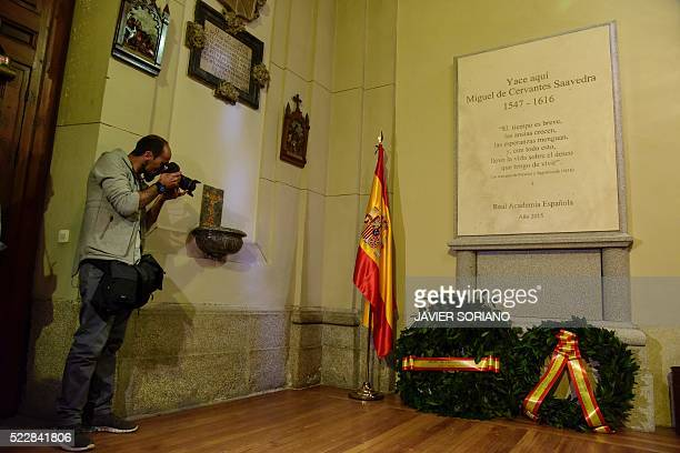 A man takes picture of the gravestone where Spanish writer Miguel de Cervantes is buried at the church of San Ildefonso in the Trinitarias Descalzas...