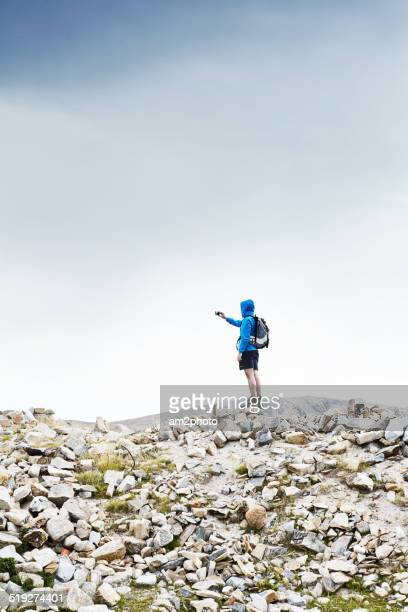Man takes picture with a smartphone in mountains