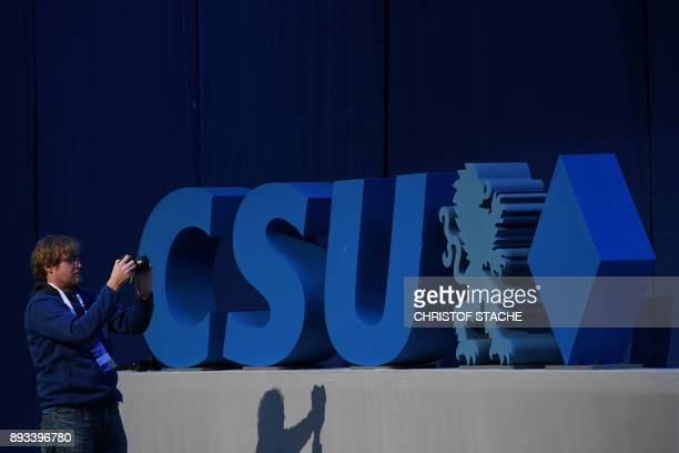 A man takes pictures of giant letters reading CSU the acronym of the conservative Christian Social Union party and the Bavarian sister party of...