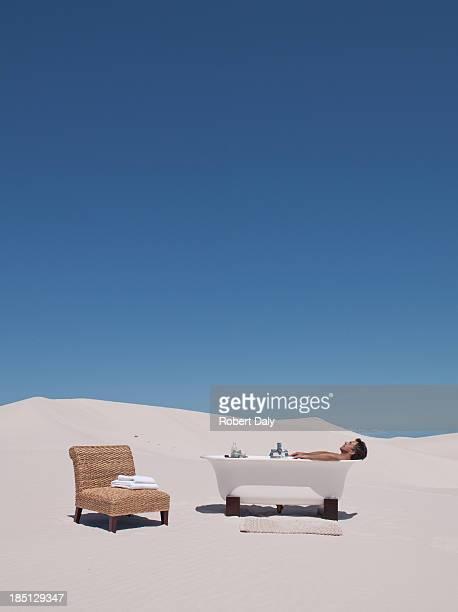 a man taking a bath outdoors - naakte man en profiel stockfoto's en -beelden