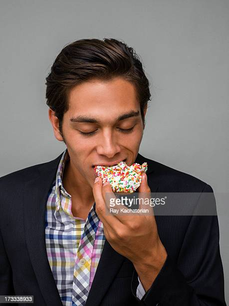 Man taking a bite out of a donut