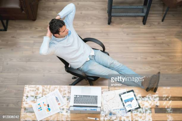 Man taking a break at work and looking very relaxed