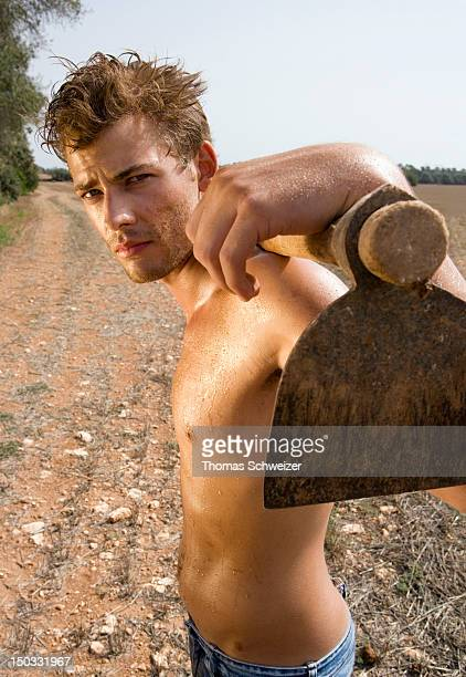 A man taking a break from his work a field