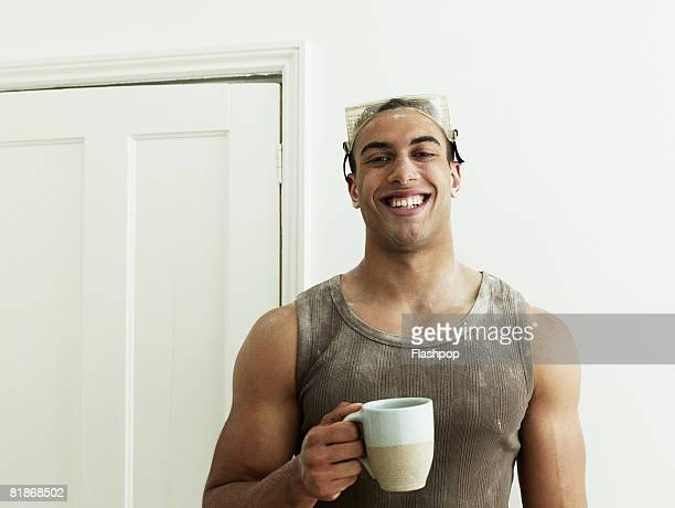 Man taking a break with a cup of coffee