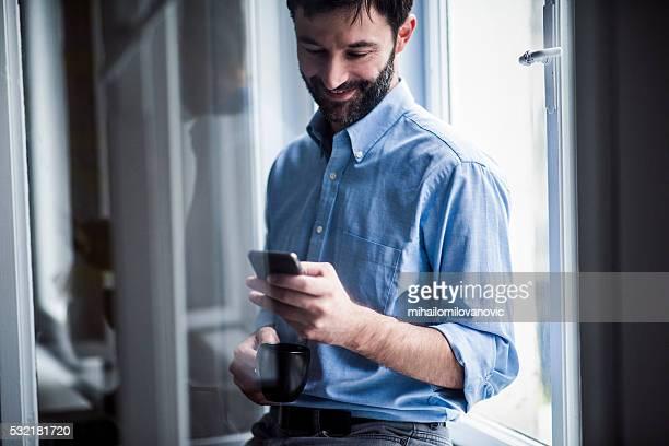Man taking a coffee break in the office