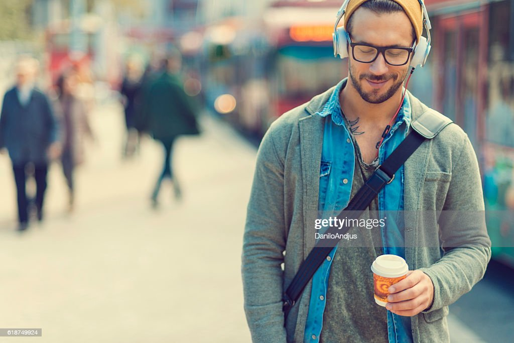 man taking a moment and enjoying the music : Stock-Foto