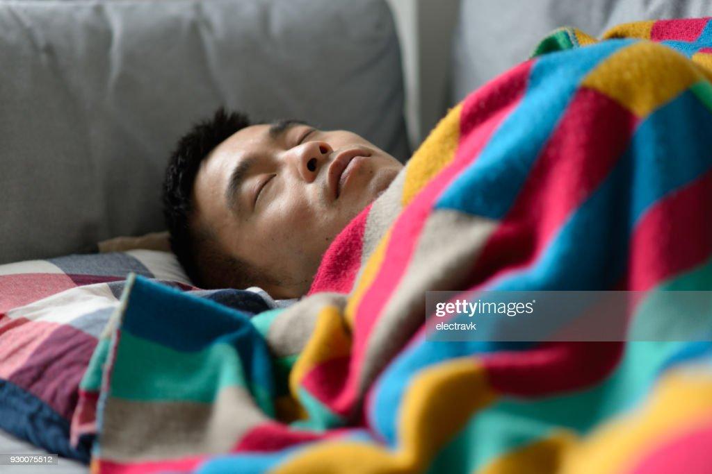 Man taking a nap : Stock Photo