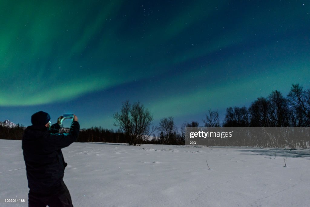 Man taking a picture of the Aurora Northern Polar light : Stock Photo