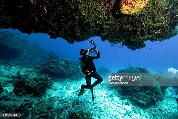 man taking a picture underwater