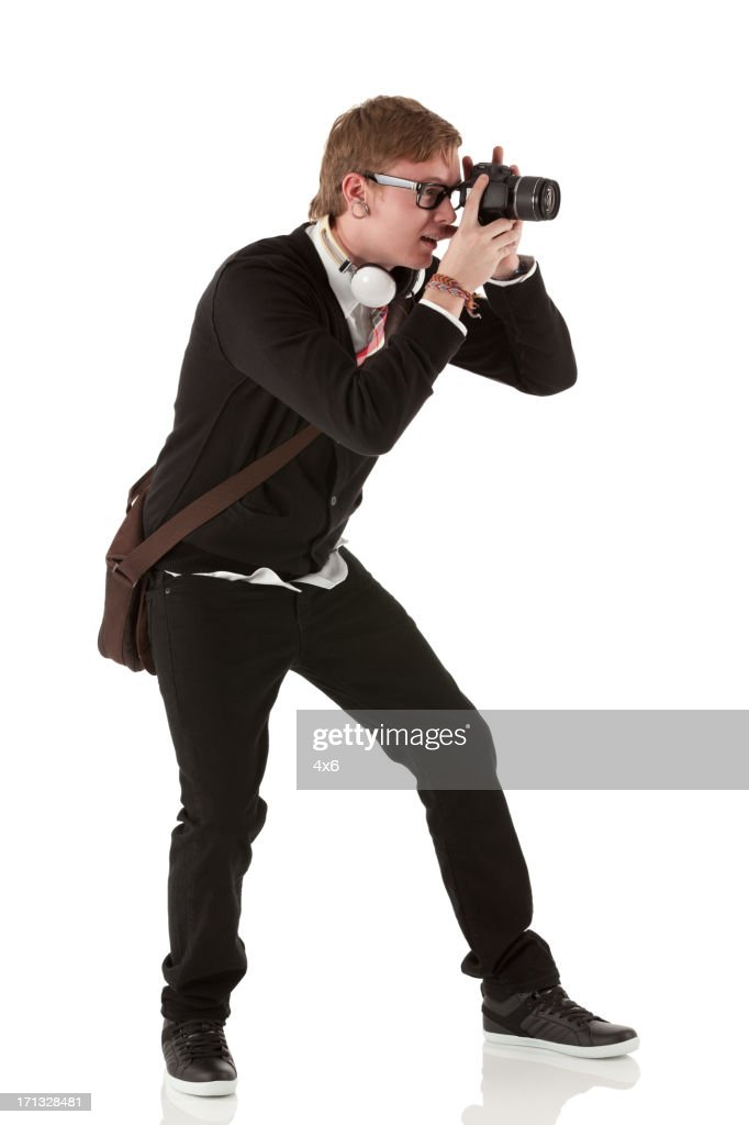 Man Taking A Picture With Camera Stock Photo | Getty Images