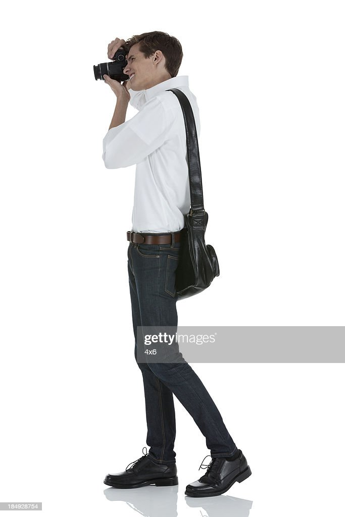 Man taking a picture with camera : Stock Photo
