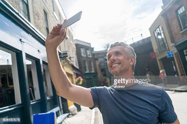 man taking a selfie outdoors - handsome 50 year old men stock photos and pictures