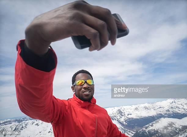 Man taking a selfie while skiing