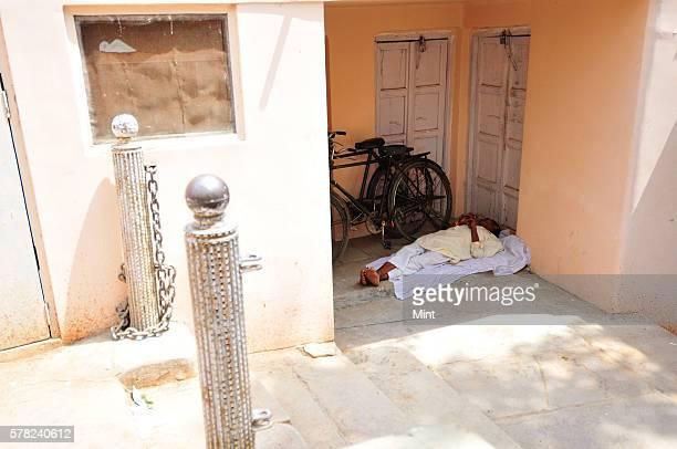 A man taking a short nap on April 26 2016 in Varanasi India Summers in India are not for the fainthearted During the afternoons the temperature in...