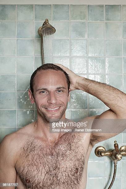 A man taking a shower in a spa