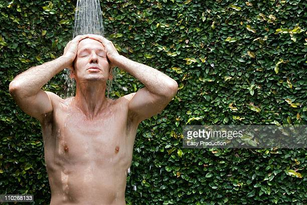 Man taking a shower outside
