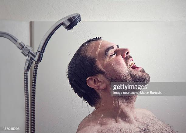 Man taking bath with help of shower