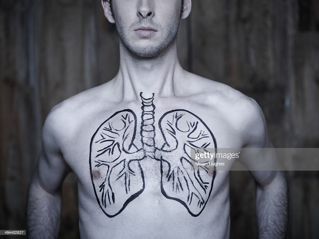 Man taking breath with lung illustration on chest : Stock Photo