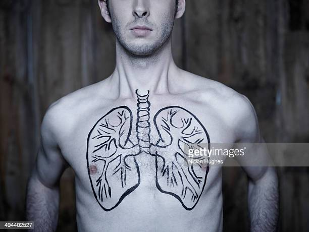 Man taking breath with lung illustration on chest