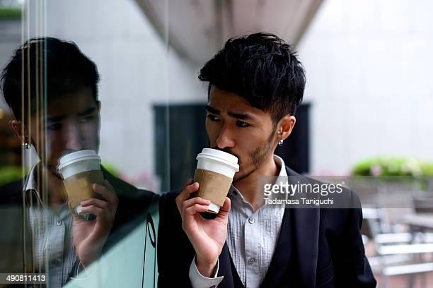 Man taking coffee