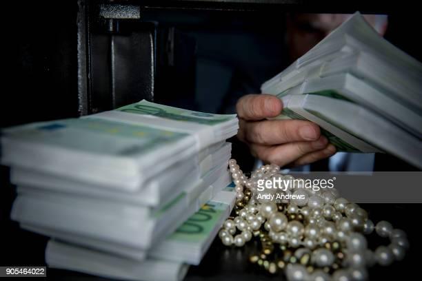 POV Man taking Euros out of a safe