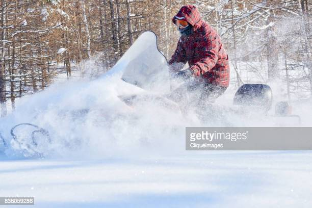 man taking extreme snowmobile ride - cliqueimages stock pictures, royalty-free photos & images