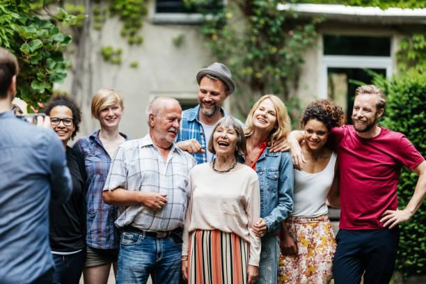Man Taking Group Photo Family - Fine Art prints
