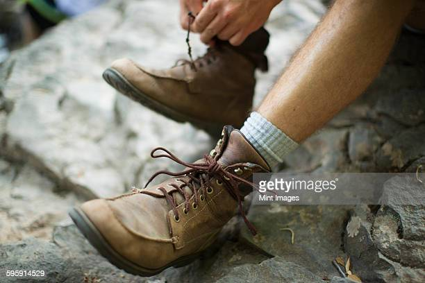 A man taking his boots off