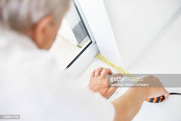 man taking measurements of the floor - measuring stock photos and pictures