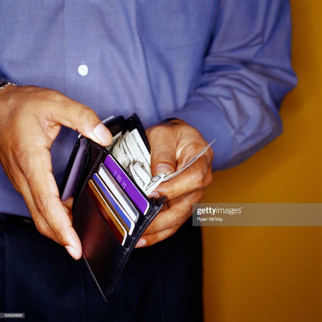 Man Taking Money out of Wallet : Stock Photo