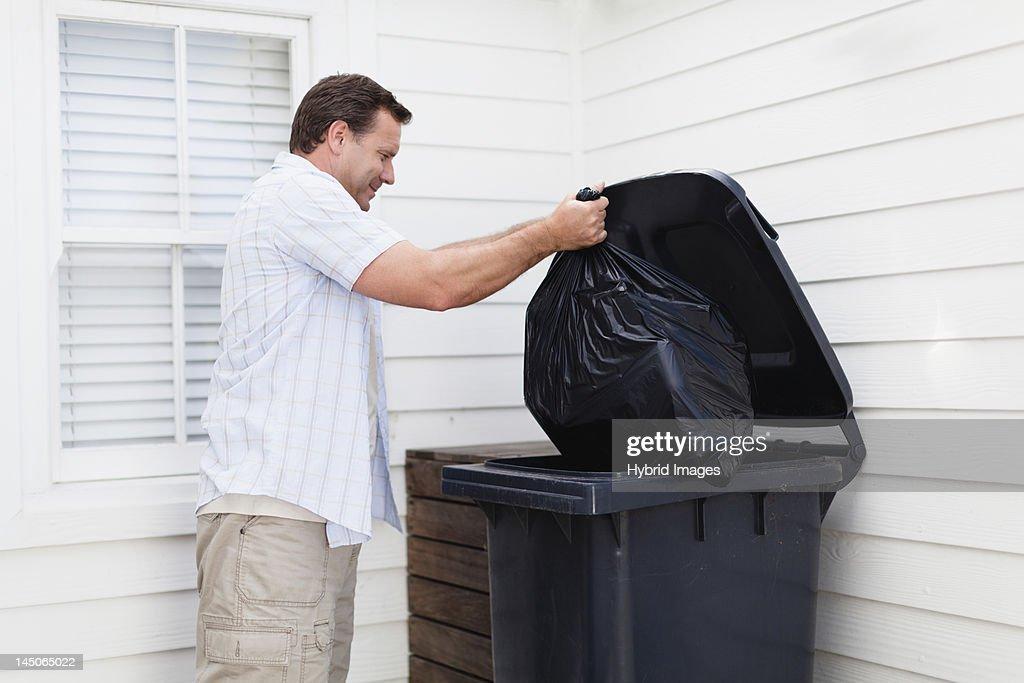 Man taking out garbage : Stock Photo