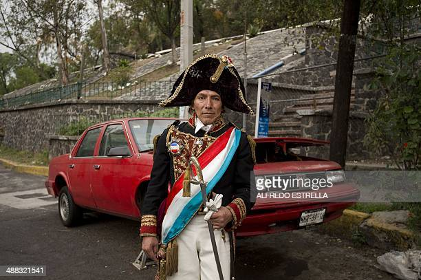 A man taking part in the commemoration of a new anniversary of Mexico's victory over France in the Battle of Puebla in 1862 poses for pictures at...