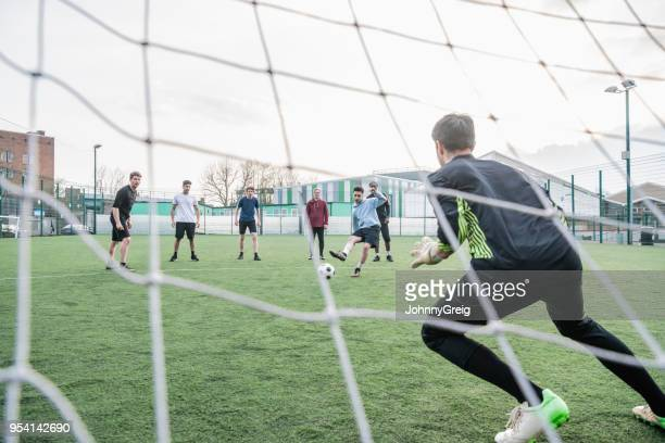 man taking penalty kick at goal - amateur stock pictures, royalty-free photos & images