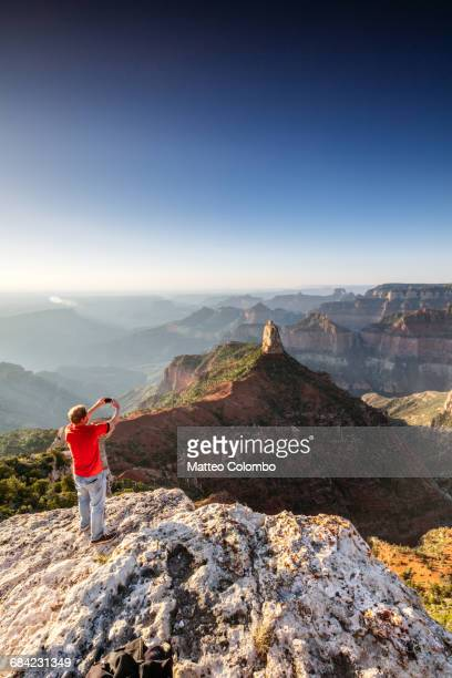 Man taking photo at Grand Canyon, Arizona, USA