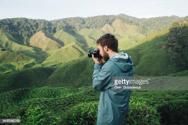Man  taking photo  at tea plantations