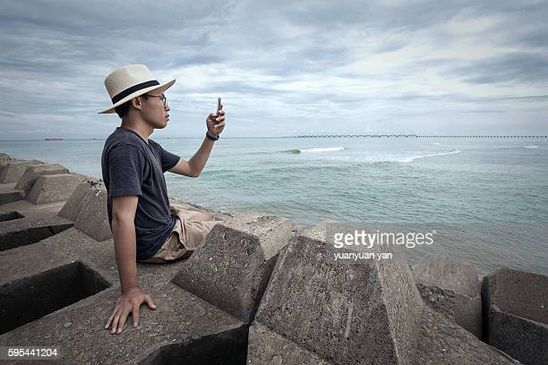 Man taking photo beside the sea