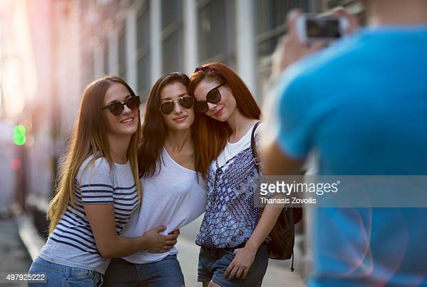 Man taking photo of her friends outdoor