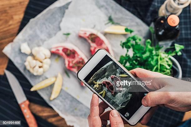 Man taking photo of his food