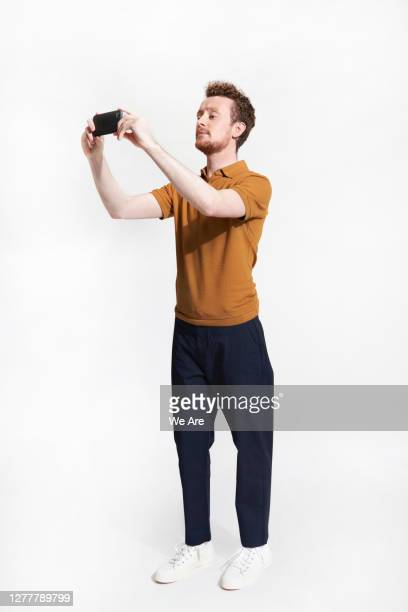 man taking photo with smartphone - photographing stock pictures, royalty-free photos & images