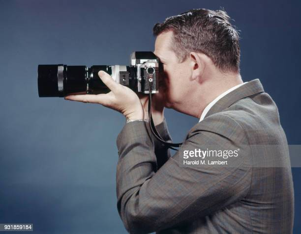 Man taking photograph with camera