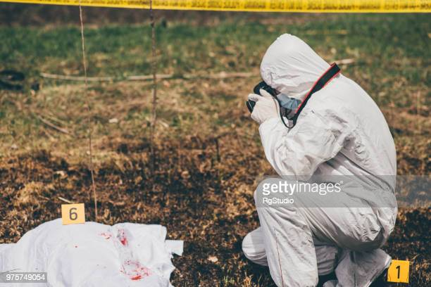 Man taking photographs of an open crime scene