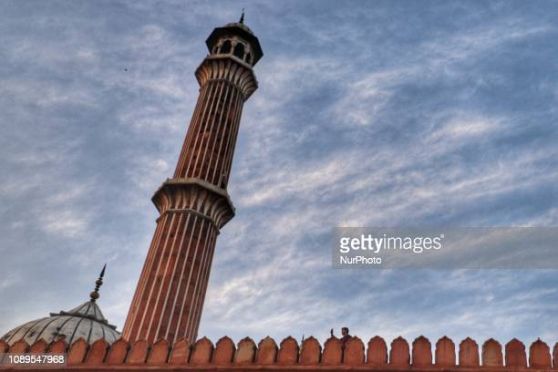 A man taking photos at historic Jama Masjid in the Old Quarters of Delhi India on 26 January 2019