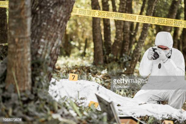 man taking photos of an open crime scene - criminal investigation stock pictures, royalty-free photos & images