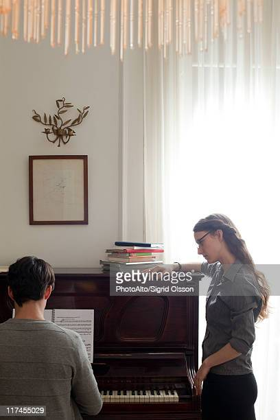 Man taking piano lessons