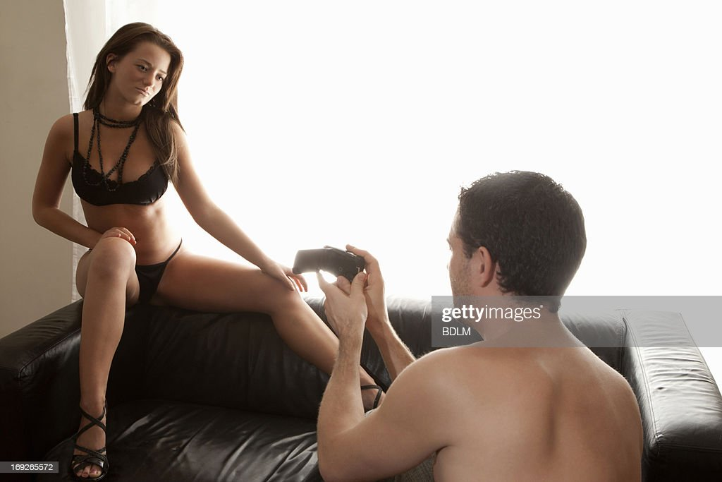 Man taking picture of nude girlfriend : Stock Photo