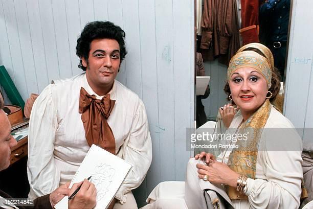 A man taking picture of Spanish tenor and conductor Placido Domingo with his wife the Mexican soprano Marta Ornelas Verona 1974