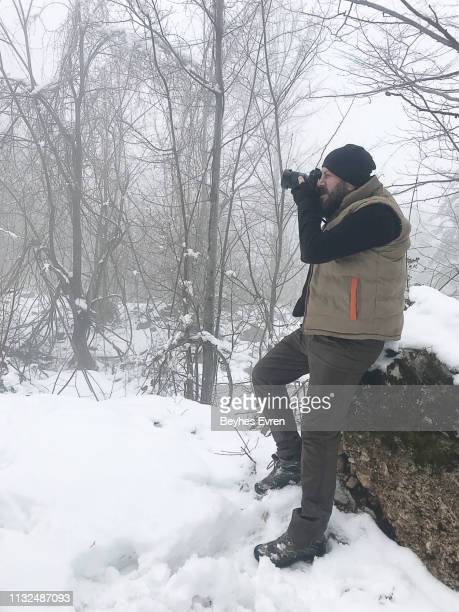 Man taking picture on a winter day