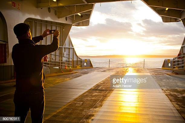 Man taking picture out ferry gate