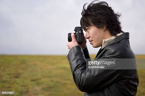 Man taking picture, side view