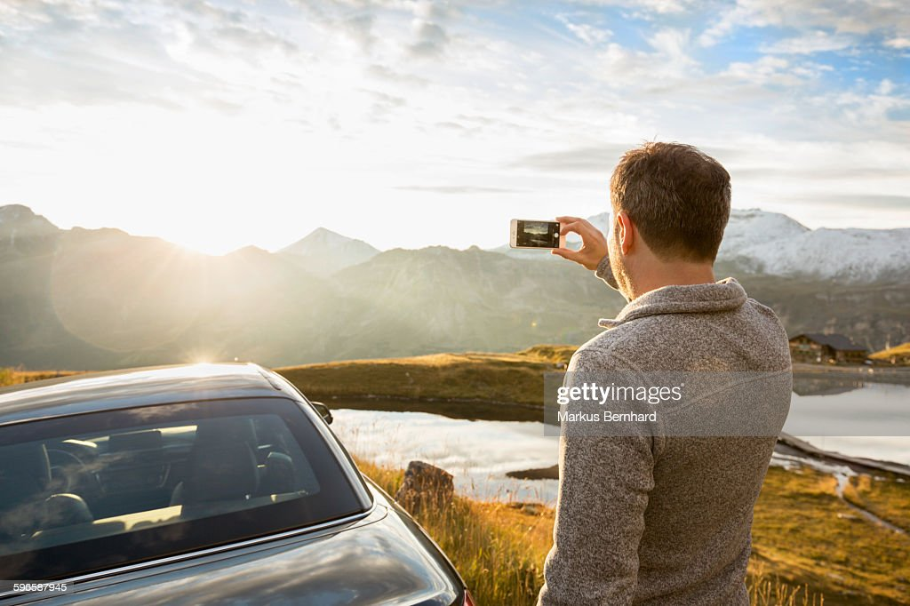 Man taking picture with his cell phone : Stock Photo